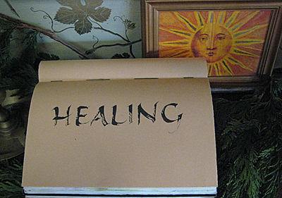 Healing written in calligraphy in journal