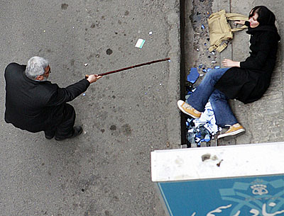 Iranian woman on ground during summer 2009 protests